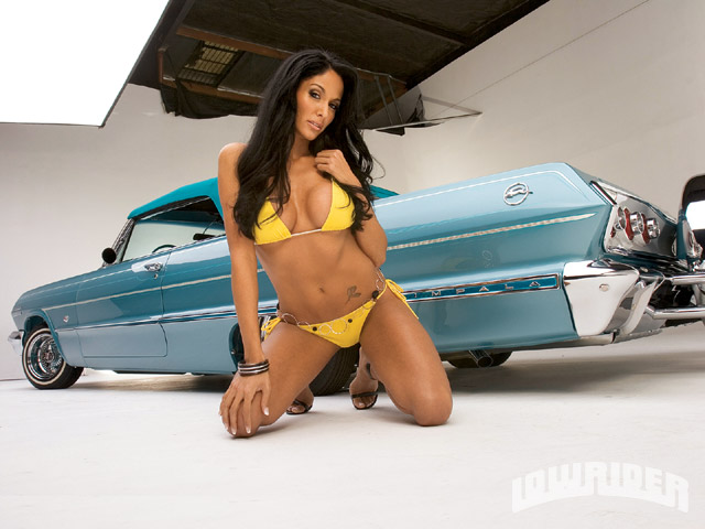 http://www.amcarguide.com/wp-content/uploads/2010/02/1963-chevrolet-impala-convertible-girl.jpg